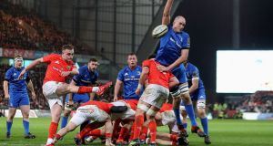Leinster's Devin Toner attempts to block the kick of Munster's Nick McCarthy during their Pro14 encounter at Thomond Park. Photo: Bryan Keane/Inpho