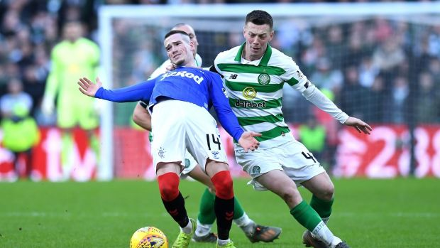 Callum McGregor tackles Ryan Kent during Caltic's defeat to Rangers. Photograph: Mark Runnacles/Getty