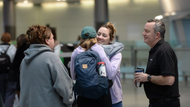 Emma Brady embraces her sister before she departs Dublin Airport for Austin, where she has been living for the last three years. Photograph: Alan Betson