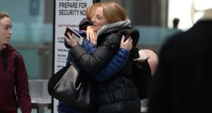 Niamh Wilson embraces her mother, Bronagh, before she departs Dublin Airport for New York. Photograph: Alan Betson