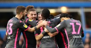 Leeds United's Jack Harrison is mobbed by teammates as he celebrates scoring his side's second goal of the game during the Championship win over Birmingham. Photo: Tim Goode/PA Wire