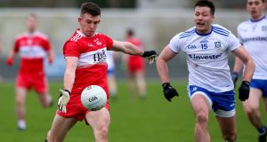 Monaghan's Dessie Ward with Shea Downey of Derry during their McKenna Cup clash. Photo: John McVitty/Inpho
