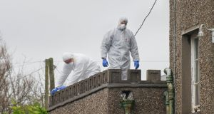 A Garda forensic team examines the scene at Castlegreina House on the Boreenamanna Road, Cork, where the body of the man was found. Photograph: Daragh Mc Sweeney/Provision