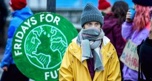 "Swedish environmental activist Greta Thunberg at a climate strike arranged by the organisation ""Fridays For Future"" outside the Swedish parliament Riksdagen in Stockholm. Photograph: Pontus Lundahl/TT via AP."