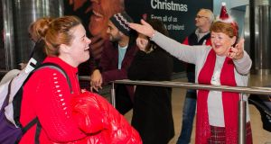 Niamh Harrington from Vancouver  greeted by her mother Carol Harrington from Cork at Dublin Airport. Photograph: Gareth Chaney/Collins