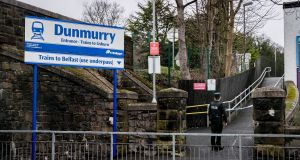 A PSNI officer attending a scene at Dunmurry railway station in west Belfast, Northern Ireland, where a person died after being struck by a train on Tuesday. Photograph: Liam McBurney/PA Wire
