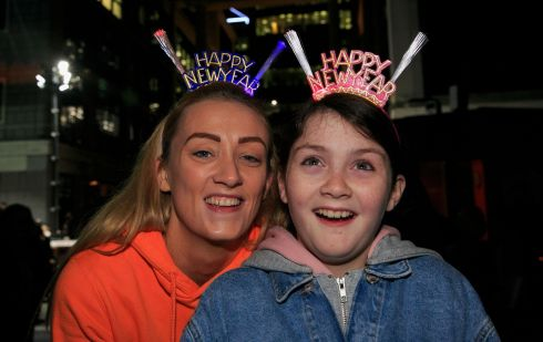 Dublin: Adrienne McDermott and her daughter Eve McDermott (aged 10) both from the city centre pictured during Liffey Lights Midnight Moment Matinee as part of New Year's Festival Dublin at the Custom House. Photo: Gareth Chaney/Collins