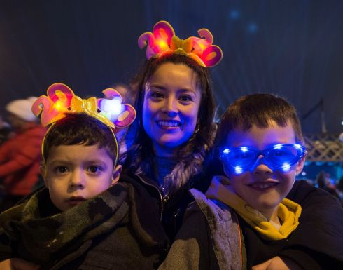 Dublin: Cillian, Lucerito & Brendan Palacios, from Dundrum, pictured at The Liffey Lights Midnight Moment, featuring dozens of musicians and a laser and light show over the Custom House, which took place on New Year's Eve 2019. Photo: Dave Meehan for The Irish Times