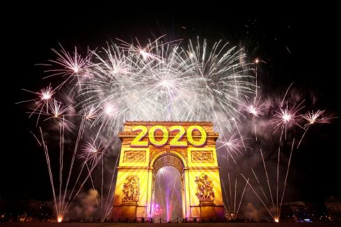 Paris: Fireworks illuminate the sky over the Arc de Triomphe during the New Year's celebrations on the Champs Elysees in Paris, France January 1, 2020. Photo: REUTERS/Benoit Tessier.