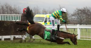 Champ, ridden by Barry Geraghty, takes a tumble with the winning line in sight. Photograph: PA