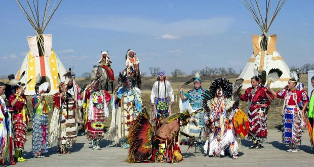 Canadian Plains Indians including Sioux, Dakato, Dene And Cree, wearing  traditional costumes dancing. Photograph: Tim Graham/Getty Images