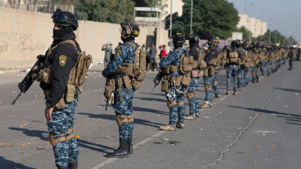 Iraqi security forces deployed in front of the US embassy in Baghdad on Wednesday. Photograph: Nasser Nasser/AP
