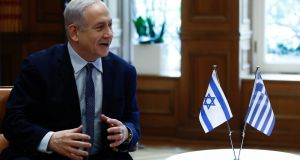 Israel's prime minister Benjamin Netanyahu is alleged to have accepted gifts from wealthy businessmen and dispensed favours to try to get more positive press coverage. Photograph: EPA/Yannis Kolesidis