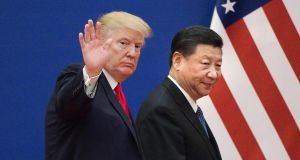US president Donald Trump and China's president Xi Jinping in Beijing in 2017. Photograph: Nicolas Asfouri/AFP via Getty Images