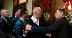 A scuffle in Montenegro's parliament in Podgorica on December 27th after opposition tried to prevent the vote on a Bill on religious freedoms and legal rights of religious organisations. Photograph: Stevo Vasiljevic/Reuters
