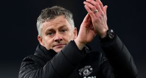 Ole Gunnar Solskjaer  applauds the travelling fans after the defeat to Arsenal. With Solskjær it's not clear there is any attacking strategy  at all beyond trying to play in the quick lads up front as they run in behind. Photograph:  Clive Mason/Getty