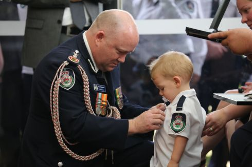 AUSTRALIA FIRES: Harvey Keaton is presented with his firefighter father's posthumous honour for bravery after his death at the Green Wattle Creek fireground, Australia. Photograph: NSW RFS/PA Wire