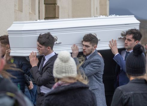 DONEGAL FUNERAL: The remains of Mary Ellen Molloy are taken from the Church of the Holy Family in Ardara in Co Donegal to the adjoining graveyard. Photograph: North West Newspix