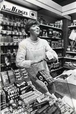 Marian Finucane behind the counter at Buckley's Newsagents in Bray in 1987, after being challenged to swap jobs with the shop's proprietor for a day. Photograph: Peter Thursfield/The Irish Times