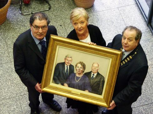 John Hume and Marian Finucane help unveil a commemorative portrait of the Irish League of Credit Union founders Seán Forde, Nora Herlihy and Séamus P MacEoin, in 2008. Photograph: Collins