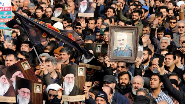 Iranians holding pictures of assassinated general Qassem Suleimani and supreme leader Ali Khamenei protest in Tehran on Friday over the US air strike that killed Suleimani. Photograph: Abedin Taherkenareh/EPA