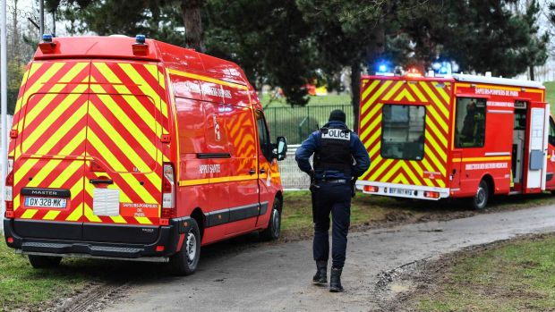 Emergency vehicles in a park in the south of Paris' suburban city of Villejuif where a man was shot and killed by officers after stabbing passersby. Photograph: Getty