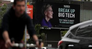 A billboard with an image of Democratic presidential hopeful Elizabeth Warren in San Francisco. Photograph:  Justin Sullivan/Getty