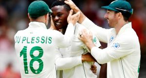 Kagiso Rabada is congratulated by South Africa captain  Faf du Plessis  after taking the wicket of Dom Sibley. Photograph: Ashley Vlotman/Gallo Images/Getty Images