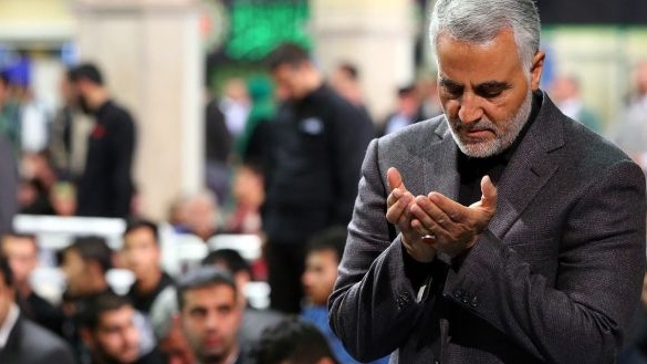 Qassem Suleimani praying during a religious ceremony in Tehran in 2015. File photograph: EPA
