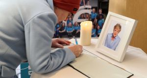 A woman signs a book of condolence at RTÉ Radio Centre in Donnybrook, Dublin, for broadcaster Marian Finucane, who died on Thursday. Photograph: Brian Lawless/PA Wire