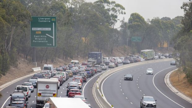 Traffic at a standstill on the M5 motorway westbound, due to a fire in Sydney, Australia, on Sunday. Photograph: Jenny Evans/Getty Images