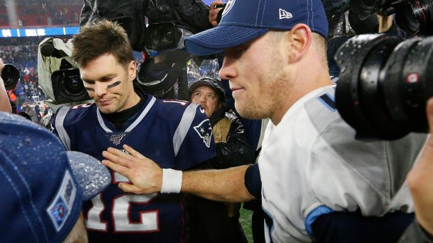 New England Patriots quarterback Tom Brady gets a pat on the chest from his Tennessee Titans counterpart Ryan Tannehill after their AFC wildcard playoff game at Gillette Stadium in Foxborough, Massachusetts. Photograph: CJ Gunther/EPA