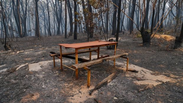 A burnt out picnic table in Wingello, Australia, on Sunday. Photograph: Brett Hemmings/Getty Images