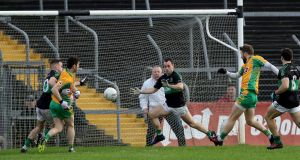Corofin's Micheal Lundy scores a goal against Nemo Rangers. Photograph: Bryan Keane/Inpho