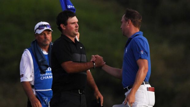Patrick Reed congratulates Justin Thomas after his play-off victory. Photograph: Harry How/Getty