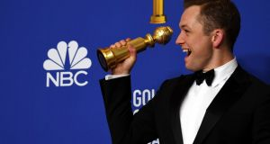 Taron Egerton holds the award for Best Performance by an Actor in a Motion Picture - Musical or Comedy for Rocket Man at the  77th annual Golden Globe Awards   in Beverly Hills. Photograph:  Christian Monterrosa/EPA