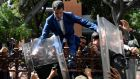 Venezuelan opposition leader and self-proclaimed acting president Juan Guaidó is helped to climb a railing in an attempt to reach the National Assembly building in Caracas, on January 5th. Photograph: Federico Parra/AFP via Getty