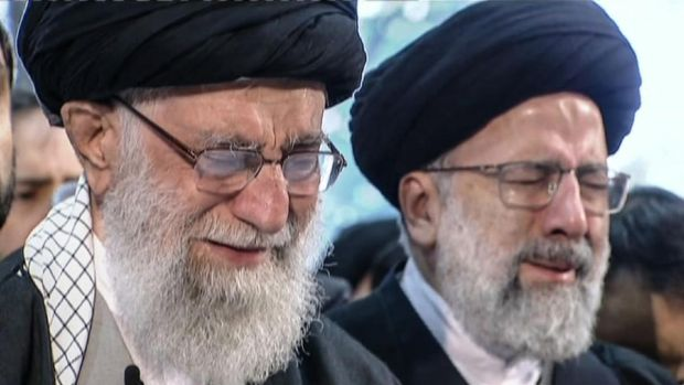 Iranian supreme leader Ayatollah Ali Khamenei (left) weeps as he recites a prayer in front of the coffin of Qassem Suleimani. Photograph: Iran Press/AFP via Getty Images