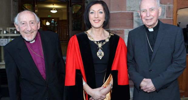 Then mayor of Derry,  Brenda Stevenson, welcomes   Dr James Mehaffey (left), retired Church of Ireland bishop of Derry and Raphoe, and Dr Edward Daly, retired Catholic bishop of Derry, to the Guildhall  in March 2015 to receive the  Freedom of the City of Derry for their cross-community leadership during the Troubles. File photograph: Lorcan Doherty Photography