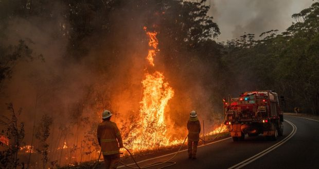 Fire crews burn off brush near Jerrawangala, Australia.  Photograph: Matthew Abbott/The New York Times
