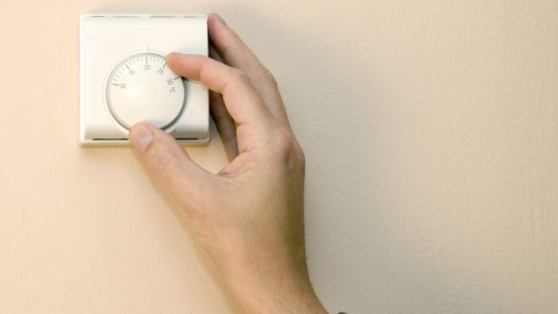 You can reduce your heating bill by 10 per cent by lowering your room temperature by just one degree Photograph: Andrew Howe/ Getty Images