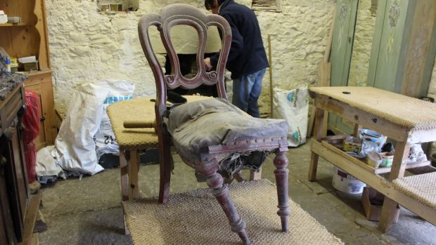 An old chair in the process of restoration at Clooneenagh House