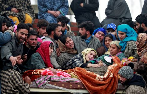 TEARS IN KASHMIR: Mourners surround the body of Adil Ahmad Dar, a suspected militant, who according to local media was killed in a gun battle with Indian security forces, at his funeral in Arwani, south Kashmir's Kulgam district, on Tuesday. Photograph: Danish Ismail/Reuters