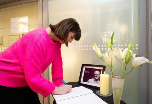 GOLDEN HOUR: Clodagh O'Hagan signs a book of condolences for late RTE DJ Larry Gogan after his deathon Tuesday. Photograph: Tom Honan