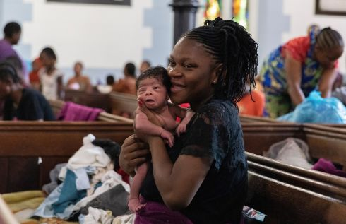 TAKING REFUGE: A woman tends to her newborn baby in the Central Methodist Church, Cape Town, South Africa. People from other African countries have been taking refuge at the church for months, after being forced to leave local communities due to xenophobic attacks. Health conditions in the church are deteriorating, according to the refugees. Photograph: Nic Bothma/EPA