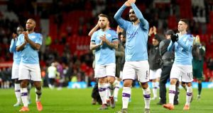Ilkay Gundogan of Manchester City acknowledges the fans after their Carabao Cup semi-final win over Manchester United at Old Trafford. Photo: Michael Steele/Getty Images