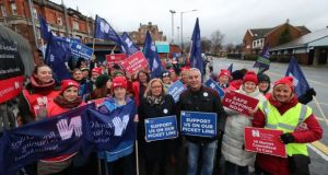 Royal College of Nursing Northern Ireland director Pat Cullen (centre) joins the picket line outside the Royal Victoria Hospital in Belfast as nurses across Northern Ireland take part in a 12-hour strike over pay in December. File photograph: Liam McBurney/PA Wire