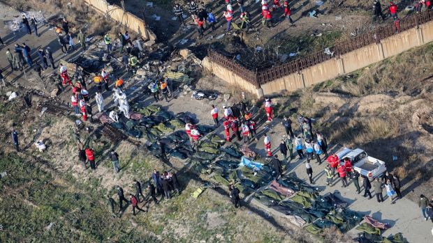 An areal view from a helicopter shows a general view of the crash site as members of emergency services workers and members of the International Red Crescent work next to the wreckage. Photograph: Ruhollah Vahdati/EPA