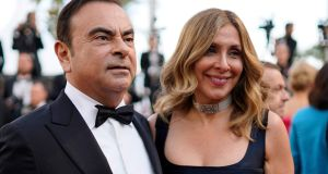 Former Nissan Motor chairman Carlos Ghosn (L) and his wife Carole Ghosn at Cannes in 2018. Photograph: EPA