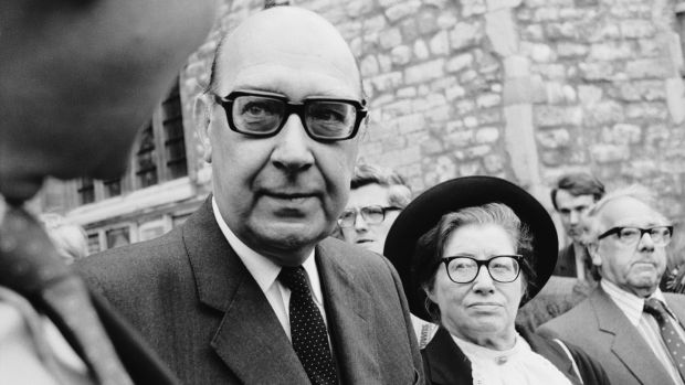 English poet Philip Larkin (1922 - 1985) with his muse and mistress Monica Jones at the memorial service for Poet Laureate Sir John Betjeman at Westminster Abbey, London on June 29th, 1984. Photograph: Daily Express/Hulton Archive/Getty Images.